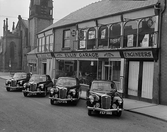 [Four Wolseley 15/50 saloons at Ellis' Garage, Oswestry]