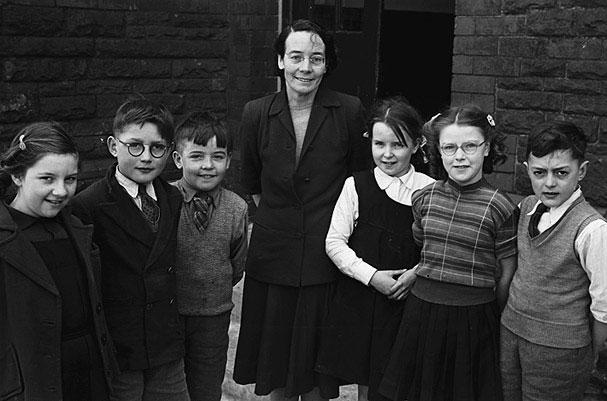 [Rhiwfawr Schoolchildren who had been successful at the Urdd Eisteddfod, with their headteacher Miss T Thomas]