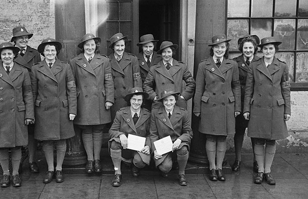 [Presentation of arm-bands and proficiency badges to WLA girls at Welshpool]