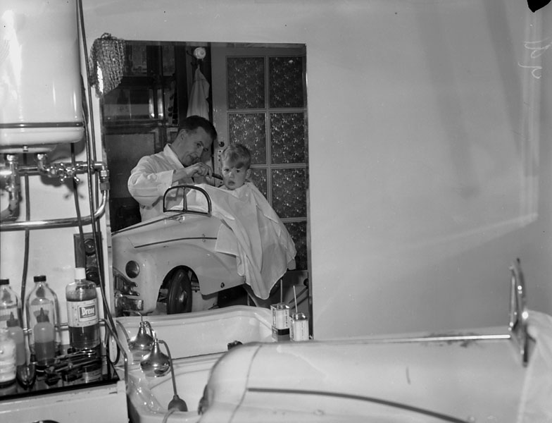 [Barber's chair at Menai Bridge in the shape of a small car]