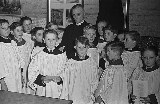 [Rev N Evans, the vicar of Worthenbury near Wrexham, with his choir boys]