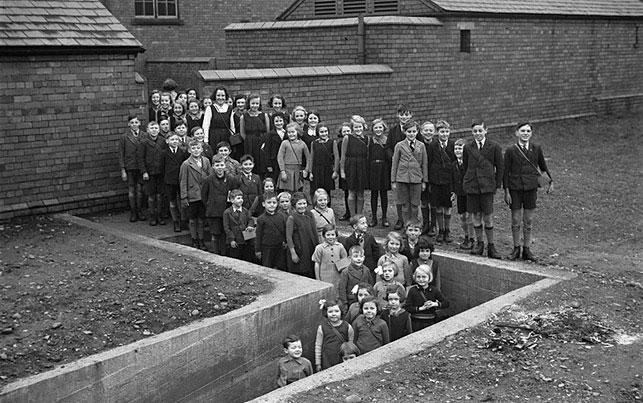 [Children outside air raid shelter, Gresford]