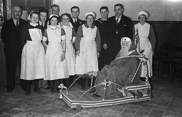 [Father Christmas at Ffordun Poor Law Institution on Christmas Day, 1940]