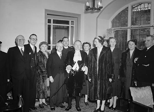 [The Judge's dinner at Dolgellau - David Tudor, the High Sheriff, with his wife and guests]