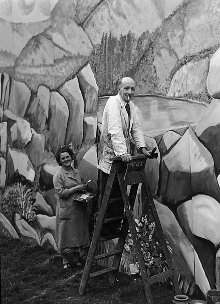 [Reginald Dennis and Marjorie Price painting the stage backdrop at the Llangollen Eisteddfod]