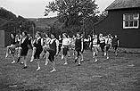 [Abermule Girls Club at PT with Miss Griffiths Davies, the County PT organiser]