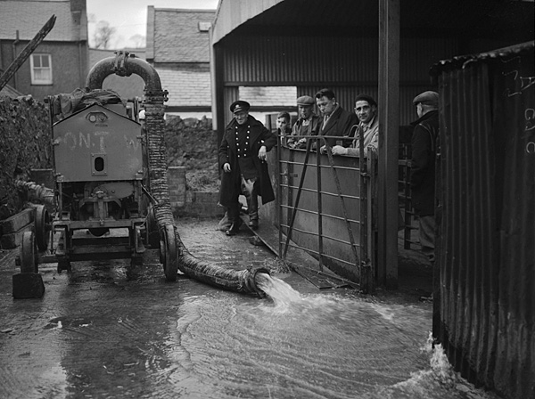 [A water pump in Pwllheli attempting to clear the tangle in the town's sewerage drains]