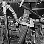 [Wilfred Hughes, craftsman and harp restorer from Fron Lledrod, Llansilin, at work]
