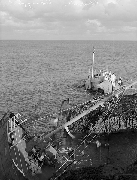 "[Wreck of the ""Hindlea"" on the rocks by Moelfre, a 100 years after the Royal Charter sank there]"