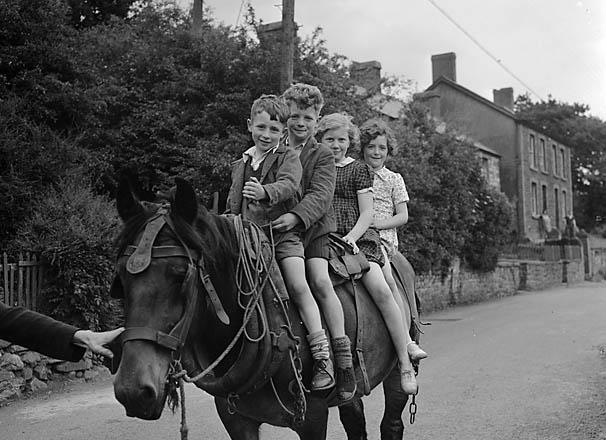 [Four children on horseback at Abercraf]