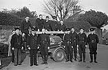 [Members of Oswestry auxiliary fire service at practice]