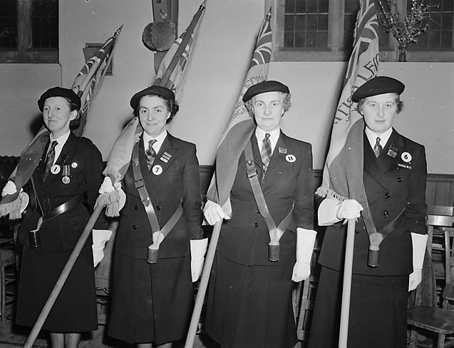 [Standard bearers representing different parts of Wales at a British Legion (Women's Section) convention]