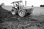Farmer ploughing with a tractor