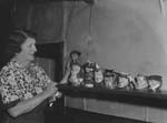 [Mrs Green, Loggerheads, with her collection of toby jugs]