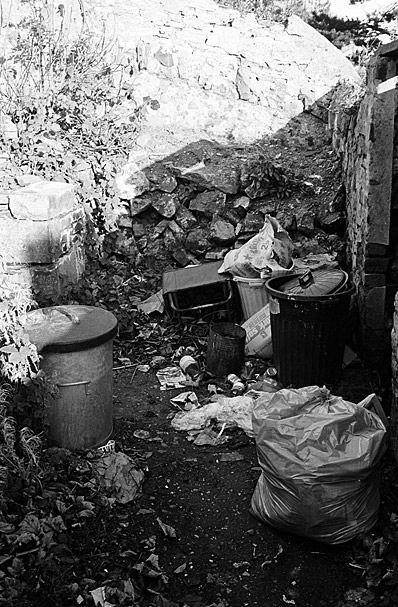 Full refuse bags and rubbish bins