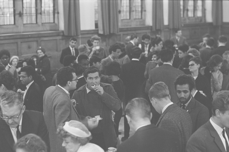 Participants taking tea at an event at Bangor University