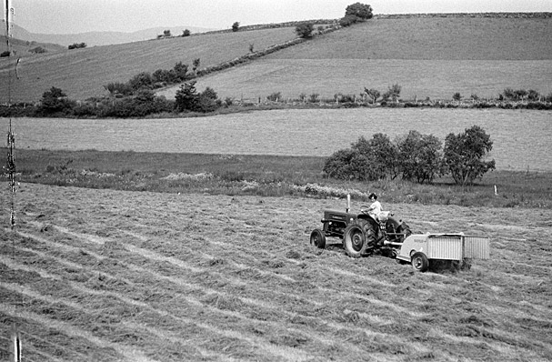 A farmer working in a field on a tractor