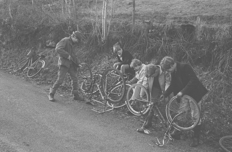 A group of boys with their bicycles