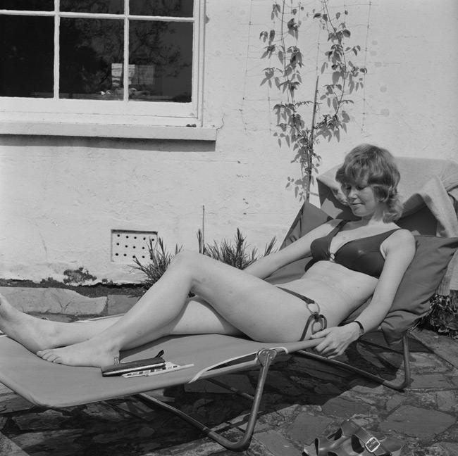 Susan Charles sunbathing