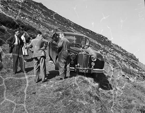 [A car accident - a Jaguar on the steep and narrow road to Nant Gwrtheyrn]