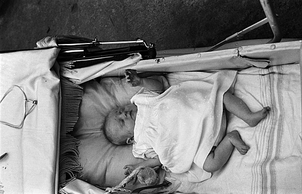 A baby sleeping in a pram