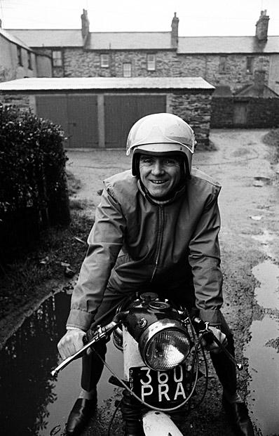 [Man on a motorbike]