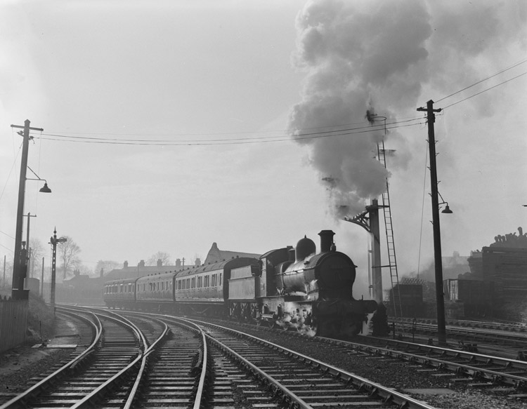 "[The British Rail engine ""Duke-Dog"" waits for a signal to draw into Oswestry station]"