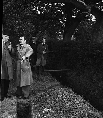 [Lord Woolton inspecting new drainage site]