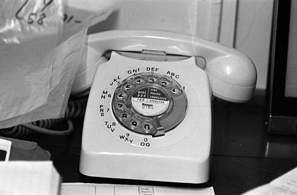 Geoff Charles' telephone and the clock in his darkroom