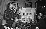 [Dick Parry, toymaker, shows some of his Christmas toys to children at his workshop in Frankwell, Shrewsbury]